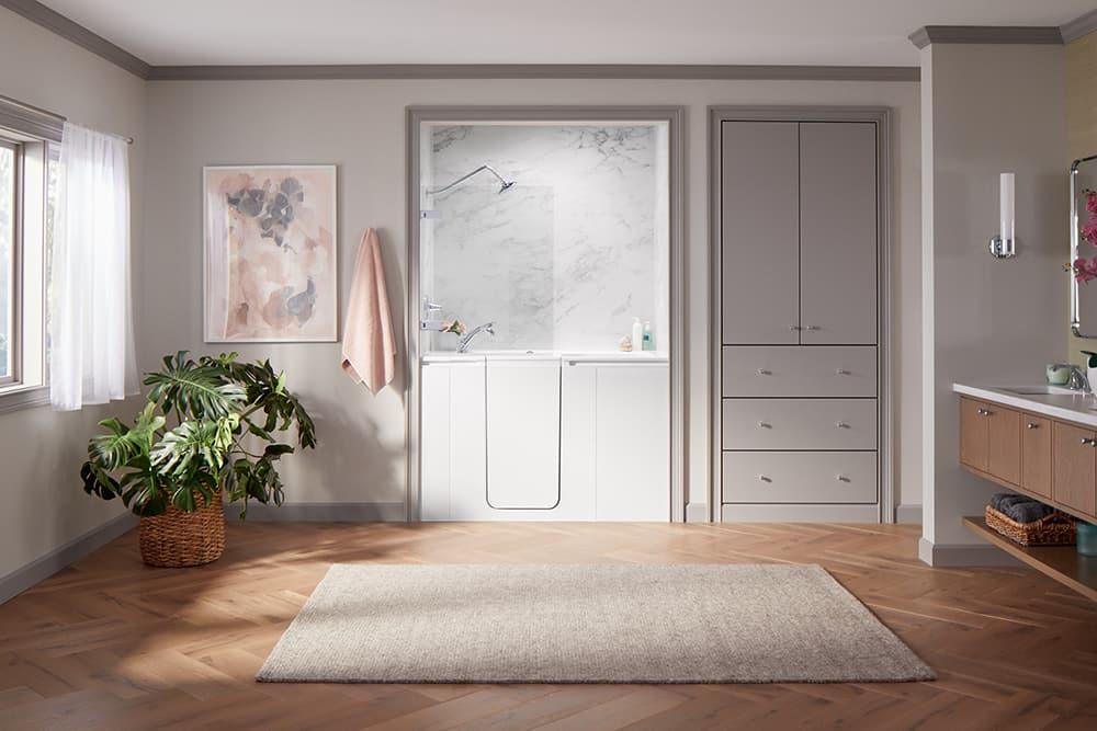 Bathroom with KOHLER Walk-In Bath featuring Shower Package