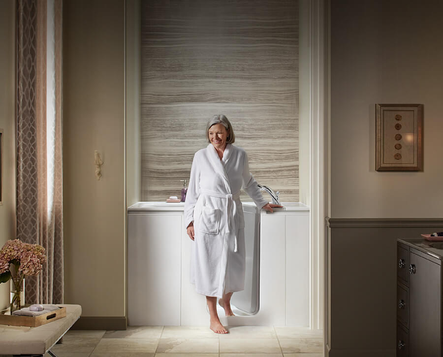 Elderly woman stepping in to walk-in tub