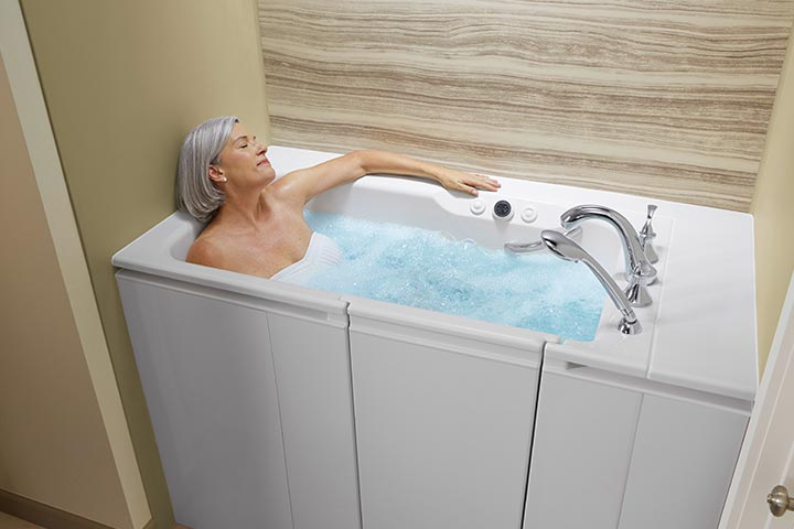 Woman bathing in walk-in tub with whirlpool jets