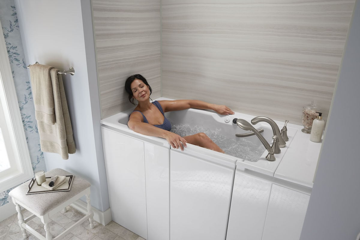 Woman soaks in KOHLER Walk-In Bath