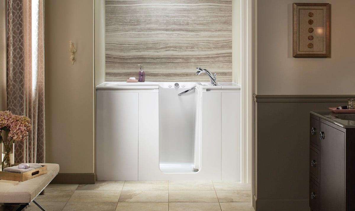 Bathtub against wall in bathroom