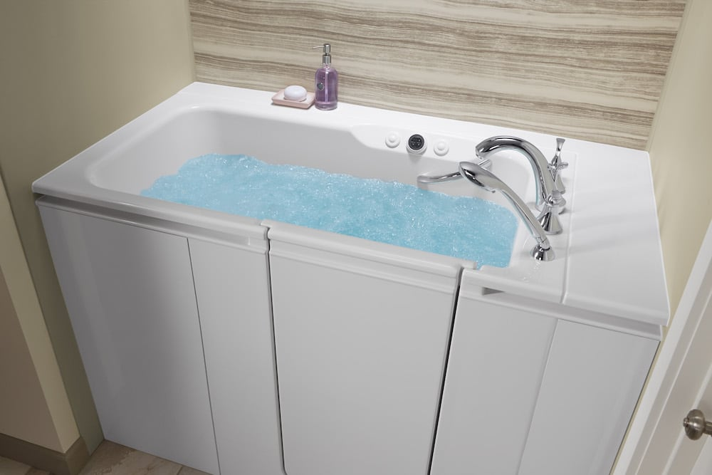 Walk-in tub filled with water.