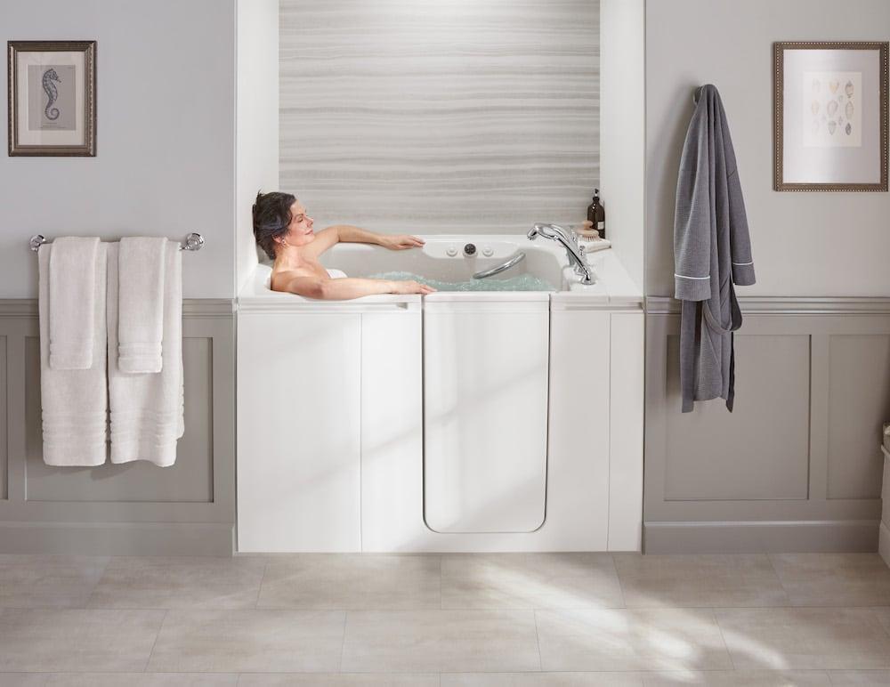 woman soaking in a kohler walk-in bath