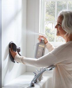 Woman Cleaning Bath Walls