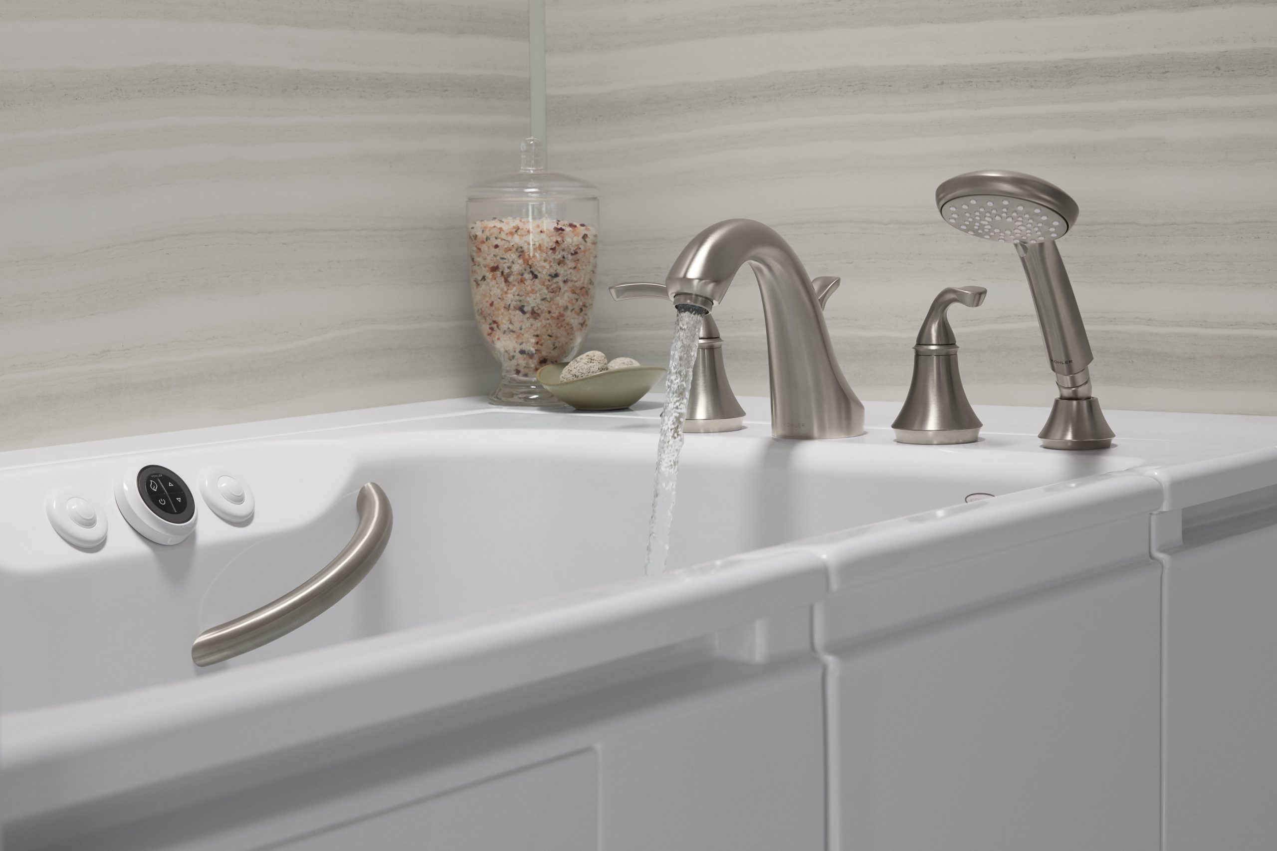 Water running from nickel faucet of walk-in bath