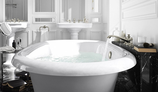 White tub with water flowing into tub