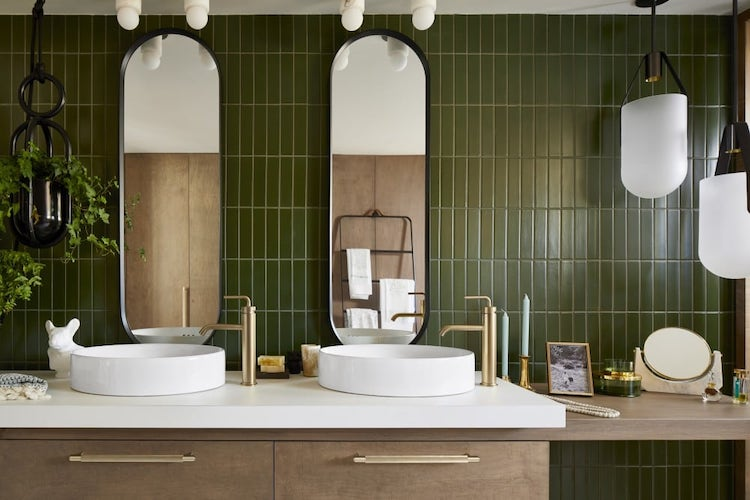 Bathroom with green walls and wooden sink
