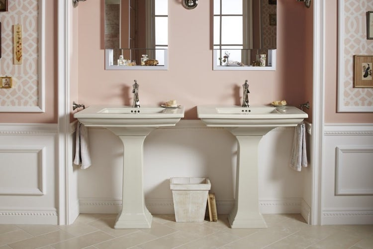 Bathroom with pink walls and white sinks