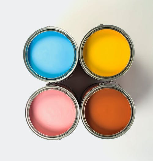 Paint cans on floor with no lid