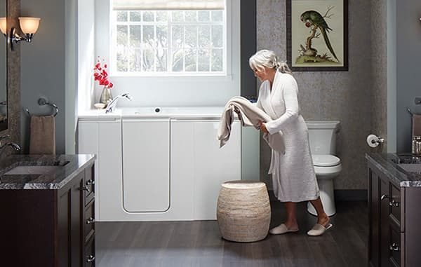 woman putting laundry into hamper
