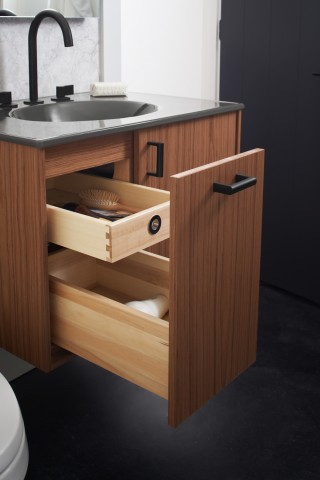 Wooden bathroom drawers open