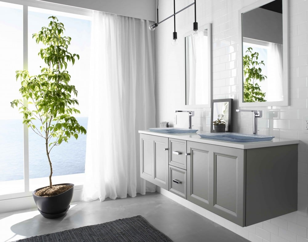 Floating grey vanity and potted tree in bathroom