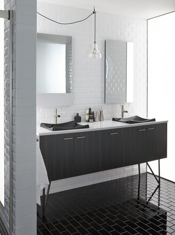 Bathroom with white subway tiled walls and a black subway tiled floor