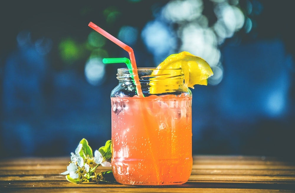 cold orange drink in mason jar