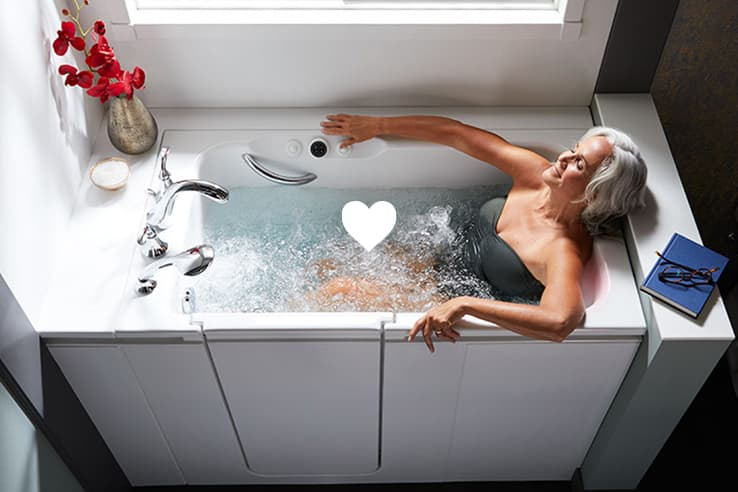 Woman relaxing in Kohler Walk-In Bath