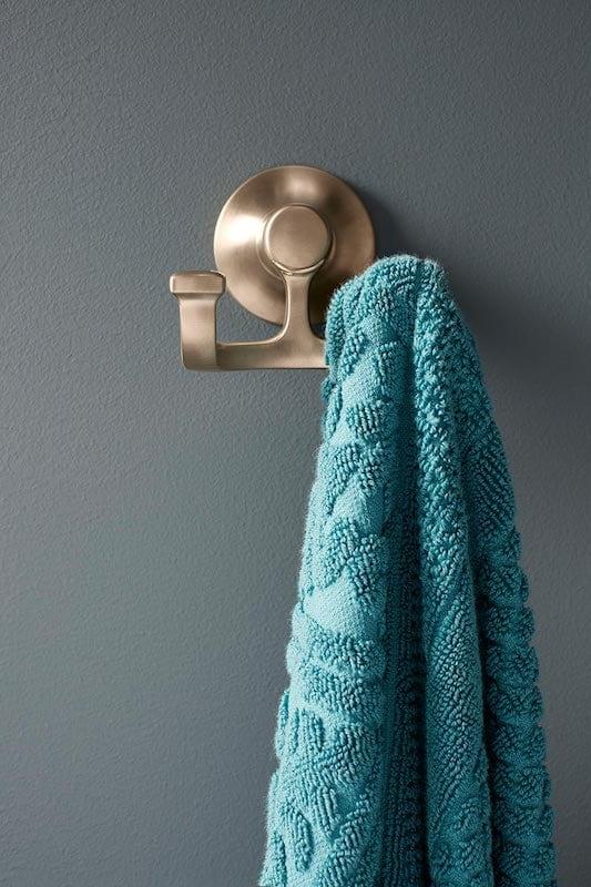 Turquoise towel on towel rack