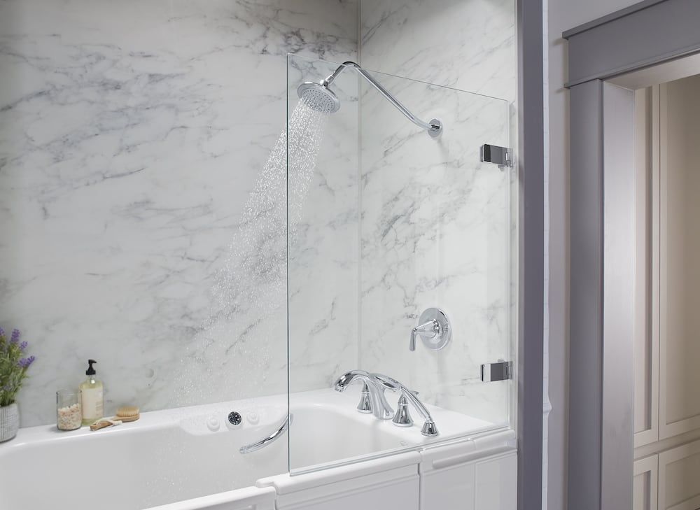 KOHLER Walk-In Bath with Shower Package spraying water