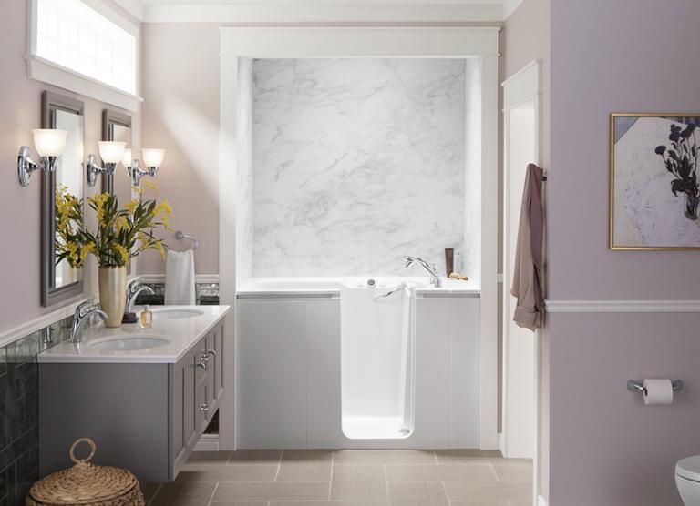 KOHLER® Walk-In Bath with Calacatta Crema bath walls