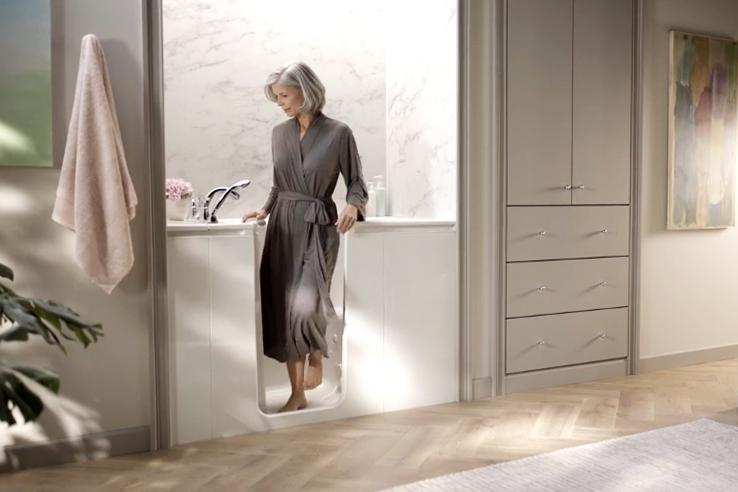 Woman exits walk-in bath