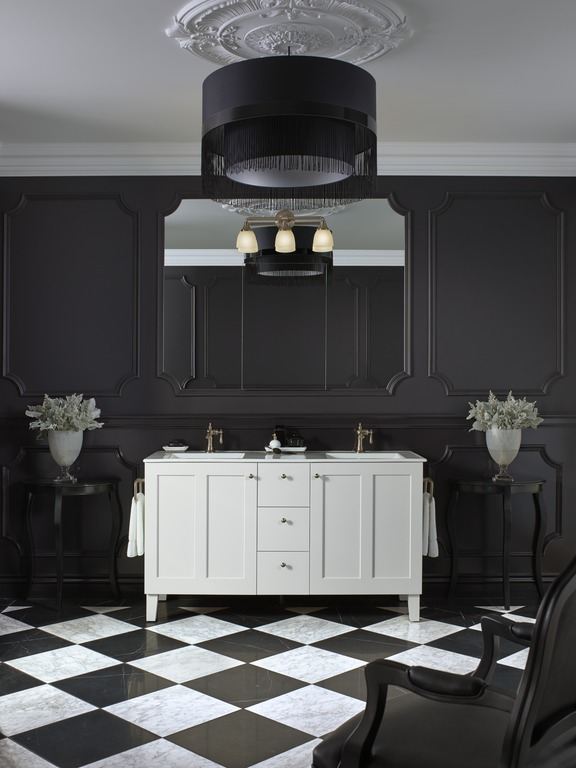 Black and white Art Deco style bathroom with white dual vanity and tiled floroing
