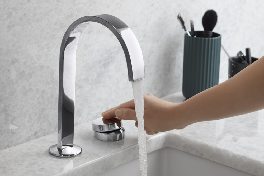 bathroom sink with running faucet